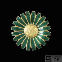 A. Michelsen. Gilded Sterling Silver Daisy Brooch with Green Enamel. 43mm.