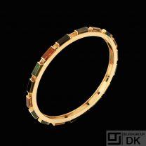 Bent Knudsen. 14k Gold Bangle with Tourmaline, Citrine and Smokey Quartz.