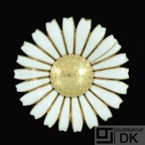 Georg Jensen. Gilded Silver Daisy Brooch / Pendant with White Enamel. 50mm