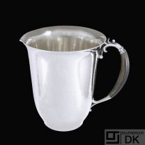 Georg Jensen. Hammered Sterling Silver Pitcher #456C - 1925-32 Hallmarks