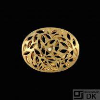 Jytte Kløve. 18k Gold Brooch with Diamond 0,02ct.