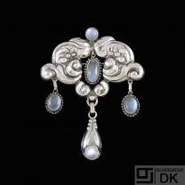 Knud Georg Jensen. Art Nouveau Silver Brooch withMoonstones.