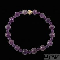 Jörg Heinz. Amethyst Bead Necklace with 18k Gold Ball Clasp with Diamonds 0.5 ct.