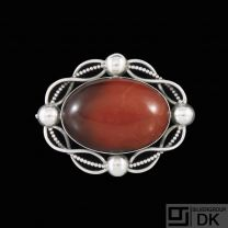 Otto Strange Friis. Art Nouveau Sterling Silver Brooch with Amber.