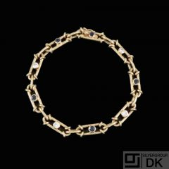 14k Gold Bracelet with Diamonds and Sapphires.