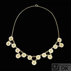 A. Michelsen. Gilded Silver Daisy Necklace with white enamel.