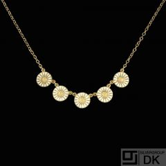 Georg Jensen. Gilded Silver Daisy Necklace with five Daisies.