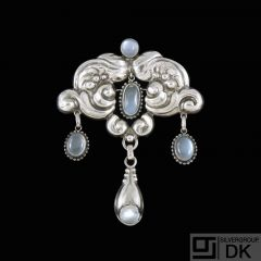 Knud Georg Jensen. Art Nouveau Silver Brooch with Moonstones.